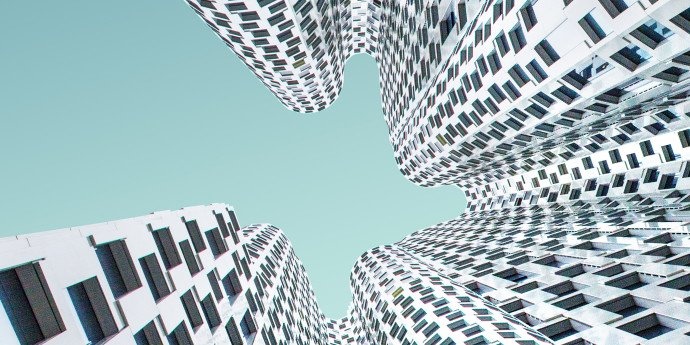 looking up at white wavy shaped building