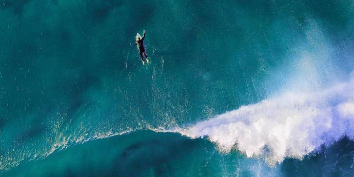 Aerial photo of surfer in waves