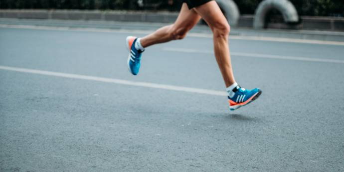 Athlete's feet running on road