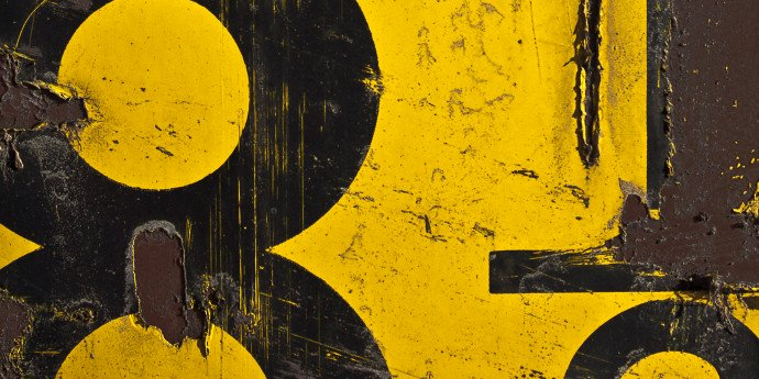 black numbers painted on yellow wall